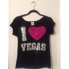 """Limited Edition Victoria's Secret Pink Top Rare T-shirt from Victoria's Secret PINK. Not sold anymore, was bought in Vegas on a trip. Has barely been worn. No sequins missing, beautiful design. """"""""I Heart Vegas"""" on the front. Love Pink"""" on the back.  No flaws.   Brand: Victoria's Secret PINK  Size: XS, fits small too  Before shipment, ALL items in my closet will be washed, ironed, and lint rolled if needed. PINK Victoria's Secret Tops Tees - Short Sleeve"""