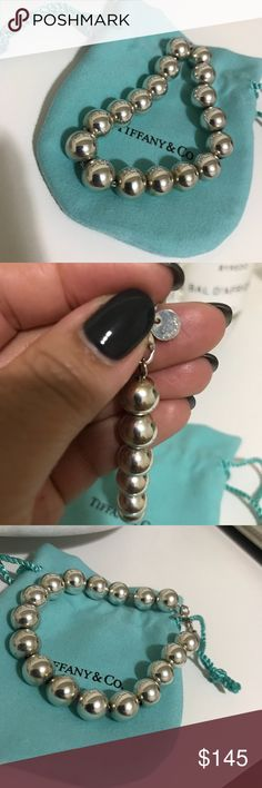 tiffany bead bracelet silver tiffany bracelet - about 2 yrs old and never wear it except once - authentic - comes with dust bag no box. Tiffany & Co. Jewelry Bracelets
