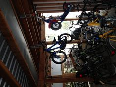 Make more space in the bike parking - Hang the small bikes up.