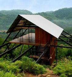 Raised up by a framework of slender steel supports, this wooden bungalow offer a vantage point over a Sri Lankan rubber plantation and the jungle beyond Container Home Designs, Tropical Architecture, Roof Architecture, Roof Design, House Design, Bungalow, Forest House, Pergola Designs, Luxury Houses
