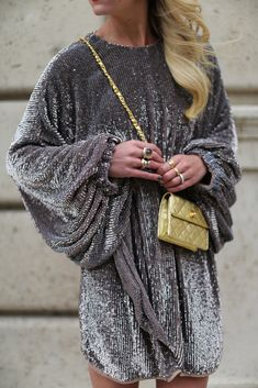 Holiday party outfit inspo: Velvet sparkly dress with long oversized sleeves and gold mini bag. | Atlantic-Pacific
