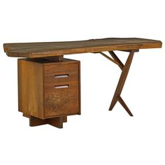 Outstanding Walnut Desk by George Nakashima | From a unique collection of antique and modern desks at http://www.1stdibs.com/furniture/storage-case-pieces/desks/
