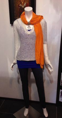 I love this Thunder Basket Ball Look. Dark blue tank under a sequin sheer back white sweater with a jersey necklace scarf. PERFECT casual yet fashionable look for the game. Let's face it, you don't want to look like you are trying TOO hard or not at all. www.tigerlilyok.com