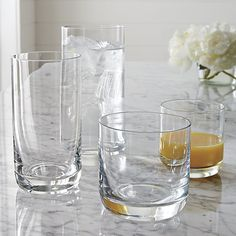 The Crescent glasses are very chic: Crescent 12 oz. Highball Glass    Crate and Barrel