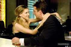 Carrie Bradshaw (Sarah Jessica Parker) and Mr. Big (Chris Noth)