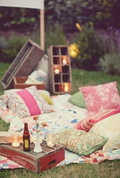 This would be a romantic way to have a picnic. Shabby Chic patterned pillows, lovely lighting. Just hope for great weather!