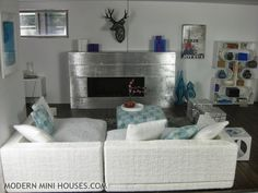 Modern Mini Houses (.com) if you have never checked into this blog do yourself a FAVOR!!!  All contemporary and modern furniture and accessories. <3