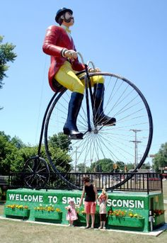 The world's largest cyclist, Ben Biken, sits in front of some of the country's most amazing bike trails in Sparta, Wisconsin.