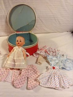 """Vintage 8"""" Unmarked Baby Suzan Doll, Round Doll Travel Case amd Clothing Lot"""