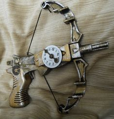 Time's Arrow, Clockwork Miniature Crossbow, WORKING steam punk dart gun.It has a clock face that charts the tension on the device's string, and is detailed with external gearing.
