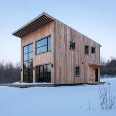 A young carpenter who wished to build his own residence was the client for this modest project by Atelier l'Abri, located in Quebec's Eastern Townships.