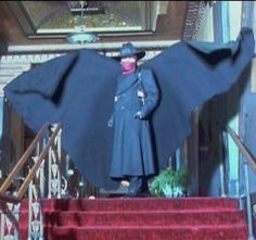 Alec Baldwin in a dynamic pose as The Shadow in the 1994 film.