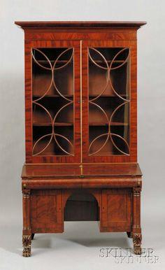 CLASSICAL CARVED MAHOGANY AND MAHOGANY VENEER GLAZED KNEEHOLE DESK/BOOKCASE, POSSIBLY PHILADELPHIA, C. 1830