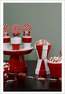 "Tablescape - DIY using terracotta pots and water trays, masking tape and red, white spray paint - when dry, ""plant"" peppermint striped lolliepops and candies"