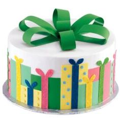 Dazzling overlapping packages make this cake truly a gift! Presents made using Sugar Sheets! surround this gorgeous cake.