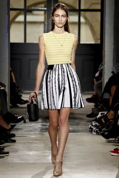 Balenciaga. Spring 2013 Ready to Wear. A pale yellow blouse with a black and white striped skirt. Girly, edgy and very nicely paired.
