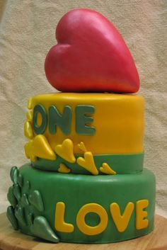Rasta - One Love - This was a graduation cake believe it or not.  Her theme was One Love and she wanted Rasta colors.  Everything is edible and handmade.