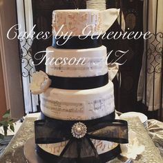 Music themed wedding cake with gum paste flowers. Black and white color scheme