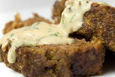 Meatloaf with beef, sausage and sauteed mushrooms. Topped with herbed cream sauce