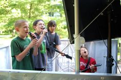 """The boys love rocking out on the Rockin' Gamin' Theatre's """"Rock Star Stage!"""""""