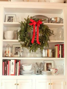 Idea for my kitchen china cabinet...remove the doors and use for cookbooks and display!