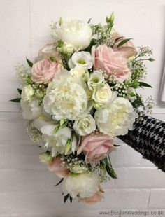 http://www.bookerweddings.co.uk - Compact Bridal Shower Bouquet in a Blush and Ivory Wedding Flower theme with peonies, roses, gypsy grass and lissianthus Side View. - Liverpool Wedding Flowers Booker Flowers and Gifts, Wedding Florist Liverpool