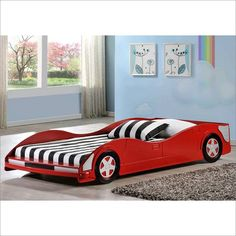 "Turn the bedroom into the racetrack with the Red Race Car Bed. Wooden bed with realistic wheels. They can cruise this low profile bed right into their dreams. Fits twin mattress. Dimensions: 82"" x 42"""