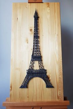 The Eiffel Tower StringArt I trademark building, the symbol of the city of romance, The Eiffel Tower is iconic and brings millions upon millions visitors every year. Relive your Paris experience right in your living room with this stylish string art replica suitable for any modern living space!