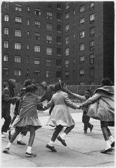 ring around the rosie....This photo reminds me of my childhood living briefly in a housing project before my mother bought a house. I didn't know I lived in a ghetto because all I remember was feeling safe and being loved.