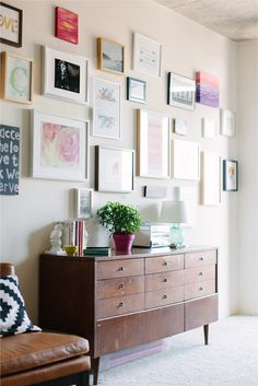 gallery wall + using a dresser as a buffet...for downstairs in our awkwardly WIDE hallway with all white frames!
