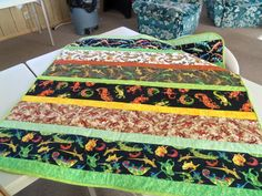 Easy strip quilt, using lizard fabric from my stash.  Made for a craft sale the Tombstone Piecemakers will hold this fall.  We make lap quilts for wounded soldiers and Vets.