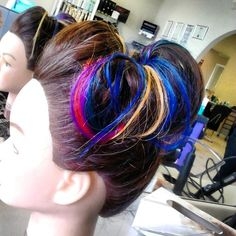 Hair up with added colored extensions