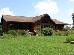 LOOK AT THIS AMAZING PROPERTY WITH 20 ACRES AND A BEAUTIFUL CEDAR HOME in Steelville, MO.