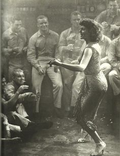 diveclearintotheday:    a-real-nowhere-tambourine-man:    Rita Hayworth and Aldo Ray (in the background) inMiss Sadie Thompson,1953    Life.  @Vanessa Villarreal