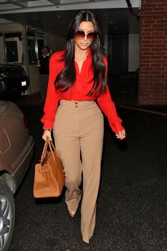 If you're curvier, try a high-wasited pant with wider waistband to flatter your shape. Also break up the look with contrasting color top, ie black & white.Add nude pumps to elongate the legs even more! Great look on Kim K. yet simple & chic enough for any woman!