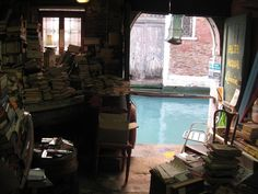 The Libreria Acqua Alta in Venice. Absolutely no order to it, looking for a specific book entails browsing stacks upon stacks. Literally getting lost in books.