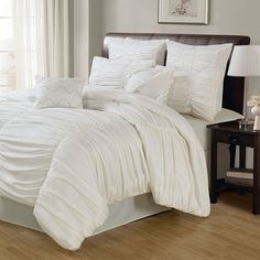 Comforter set in white with ruched detailing and matching accent pillows.   Product: Queen: 1 Comforter, 2 Euro shams, ...