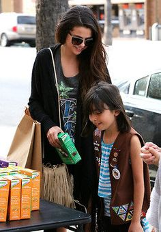 Selena Gomez buys Girl Scout cookies!