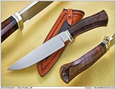 Carbon fiber reinforced walnut handle on this mid-sized camp knife by Dan Farr