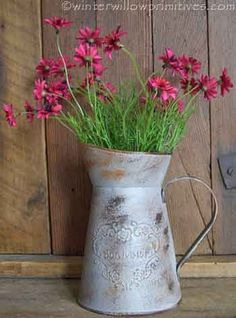 """Distressed Metal Pitcher 