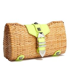 This woven wicker clutch gets an update with neon leather accents and tough pyramid studs, making it the black sheep of the picnic basket family.