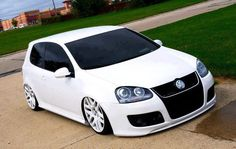 I wish my son would get this car. Gti vw white tinted rims #Audi Accessories. Check them out at #Rvinyl http://www.rvinyl.com/Audi-Accessories.html