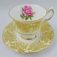 Paragon Tea Cup and Saucer Yellow and Gold with Rose Vintage