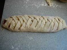 On a baking sheet, lay out a rectangle of refrigerated pizza dough, fill the middle 1/3 with sauce, toppings, and cheese.  Cut the side 1/3rds into strips just short of the sauce.  Lace the strips and bake.