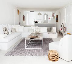 All white living room with prints and wooden accents // Mediterranean Villa