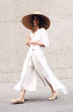 minimalist summer silhouette with long white layers and linen cropped  pants