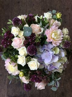 A lovely mix of soft pinks and deep purples including dahlias, mini alliums, hydrangea, marjoram and sweet avalanche roses made by Alice
