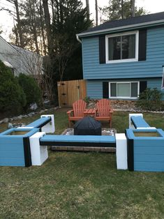 Front yard fire pit with benches made from cinder blocks, 4x4s and patio pavers.     Planters on each end.