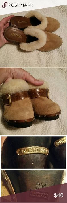"""Michael Kors tan leather clogs In excellent condition.  Suede leather material with sherpa fleece trim. Gold studs and buckle on the side and name plate on the back. Wooden 4"""" heel. Round toe MICHAEL Michael Kors Shoes Mules & Clogs"""