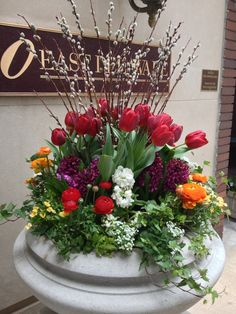 Red Tulips, Pussy Willow Branches, Purple Hyacinth, White Stock in middle, Red and Orange Ranunculas, Yellow Nemesia, White Allysum and Ivy / 40 E Delaware, Chicago, IL Easter Flowers, Spring Flowers, Chinese New Year Flower, Spring Branch, Willow Branches, Planter Ideas, Red Tulips, Outdoor Planters, Container Flowers